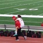 Coach Jim carries Johannah Moz off the soccer field