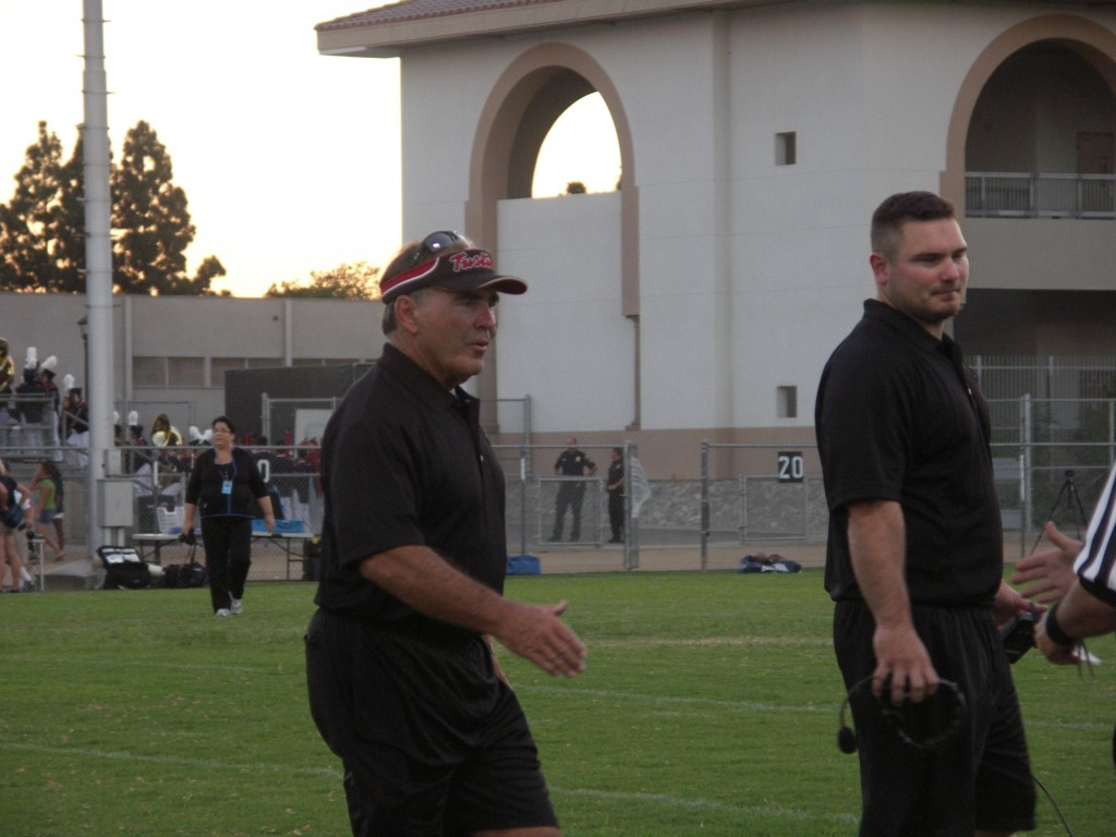 Coach Miller and Coach Welz talk to the refs before one of their games in 2010.